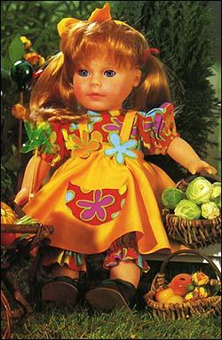 Кукла в комбинезоне и фартучке